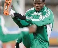 Nigeria's Taye Taiwo stretches during a soccer practice in Bloemfontein, South Africa, Wednesday, June 16, 2010. The Nigerians are preparing for their World Cup group B soccer match against Greece on Thursday. (AP Photo/Rick Bowmer)